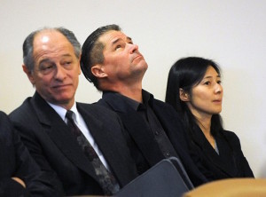 Falcon's parents, Richard and Mayumi, appear in court.