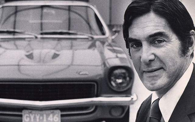John DeLorean posing with the 1970 Chevy Vega.